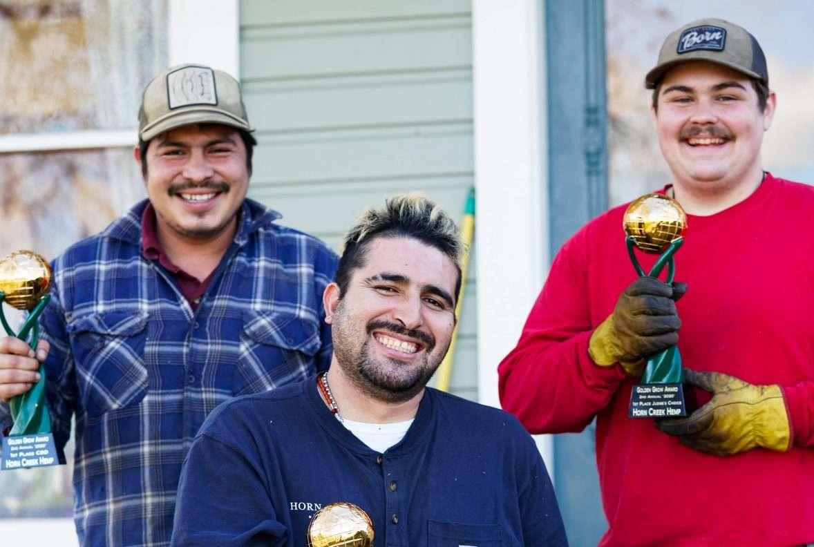 horn creek team members holding awards